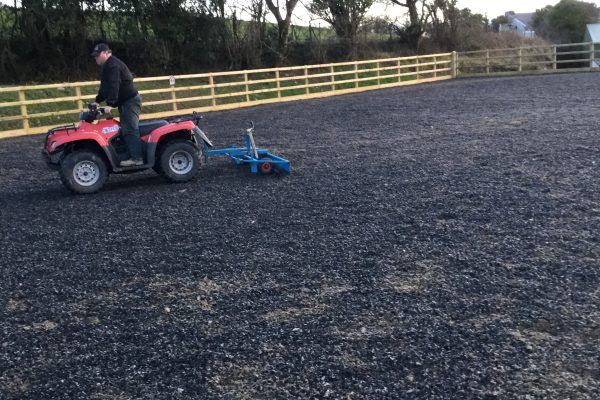 Danny grading an arena for a past client
